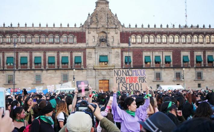 Protesters at a femicide protest in Zocalo, Mexico City, the day after International Day for the Elimination of Violence Against Women in 2019. (Wikimedia Commons)