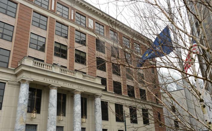 The Alaska and national flags fly at half-mast on Tuesday, April 6, 2021 in front of the Alaska State Capitol in Juneau. (James Brooks / ADN)