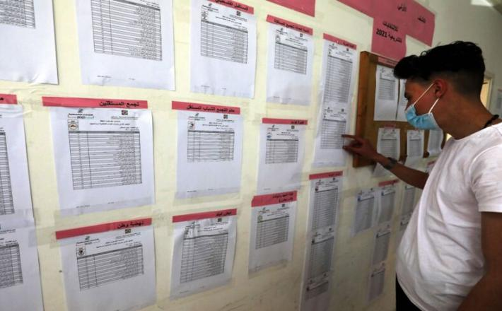 Staff of the Palestinian Central Elections Commission display electoral lists ahead of the upcoming general elections, at the commission's local offices in Ramallah in the occupied West Bank, on April 6, 2021. - ABBAS MOMANI/AFP via Getty Images