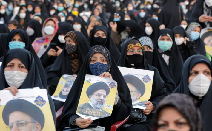 Women supporters of Iran's presidential election favourite, ultraconservative judicary chief Ebrahim Raisi, attend a campaign rally in the city of Eslamshahr, just south of Tehran - AFP/File