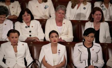 Rep. Alexandria Ocasio-Cortez watches President Donald Trump's State of the Union address at the U.S. Capitol Building on Feb. 5, 2019. A group of female Democratic lawmakers chose to wear white in a nod to the suffragist movement. ALEX WONG/GETTY IMAGES