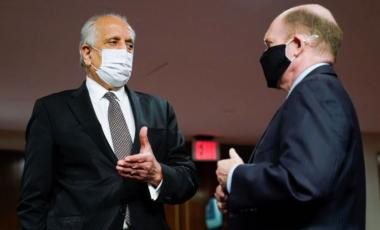 Zalmay Khalilzad, special envoy for Afghanistan Reconciliation, talks with U.S. Senator Chris Coons (D-DE), before the start of a Senate Foreign Relations Committee hearing on Capitol Hill in Washington, U.S., April 27, 2021. Susan Walsh/Pool via REUTERS