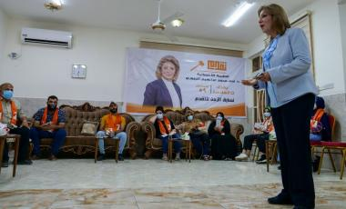 Nada al-Jubori, a candidate in Iraq's upcoming parliamentary elections, speaks to her supporters in Baghdad, Iraq September 9, 2021. REUTERS/Charlotte Bruneau