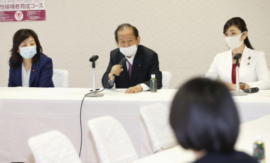 Toshihiro Nikai (C), secretary general of the ruling Liberal Democratic Party, speaks at a meeting with female lawmakers of the party on March 15, 2021, at the party headquarters in Tokyo. (Kyodo)