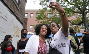 Acting Mayor Kim Janey, left, takes a selfie with Mikey Miles as she meets people in Boston's Nubian Square for a Juneteenth 2021 event.(Elise Amendola / Associated Press)