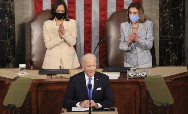 In a historic first, President Biden was flanked by two women — House Speaker Nancy Pelosi and Vice President Harris — as he addressed a joint session of Congress at the U.S. Capitol on Wednesday. Chip Somodevilla/Bloomberg via Getty Images