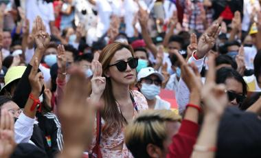 Anti-coup protesters flash the three-fingered salute during a rally in downtown Yangon, Myanmar on Feb. 19, 2021. (AP Photo)