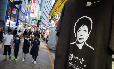 A T-shirt featuring a portrait of Tokyo Gov. Yuriko Koike displayed at a store on the Ameyoko shopping street in Tokyo on Sept. 5. (Kentaro Takahashi/Bloomberg)