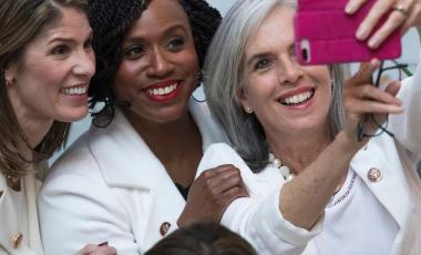 Rep. Ayanna Pressley poses with Assistant Speaker of the House Katherine Clark. (@AyannaPressley / Twitter)