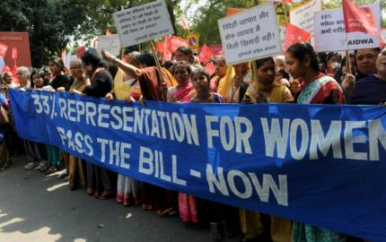 Activists from All India Democratic Women's Association (AIDWA) shout slogans demanding the passing of the Women's Reservation Bill near parliament house in 2011 in New Delhi [File: Raveendran/AFP]