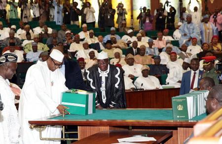 Nigerian President Muhammadu Buhari in the Nigerian Senate in 2015. There are very few women representatives. Sunday Aghaeze/AFP via Getty Images