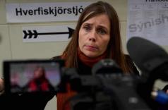 Iceland's prime minister, Katrín Jakobsdóttir, speaks to the media at a polling station in Reykjavik on Saturday. Photograph: Halldor Kolbeins/AFP/Getty