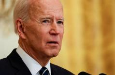 FILE PHOTO: U.S. President Joe Biden speaks to reporters as he holds his first formal news conference in the East Room of the White House in Washington, U.S., March 25, 2021. REUTERS/Leah Millis