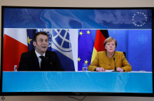 French President Emmanuel Macron and German Chancellor Angela Merkel attend a video conference at The Elysee Palace in Paris, France, January 11, 2021. Ludovic Marin/Pool via REUTERS